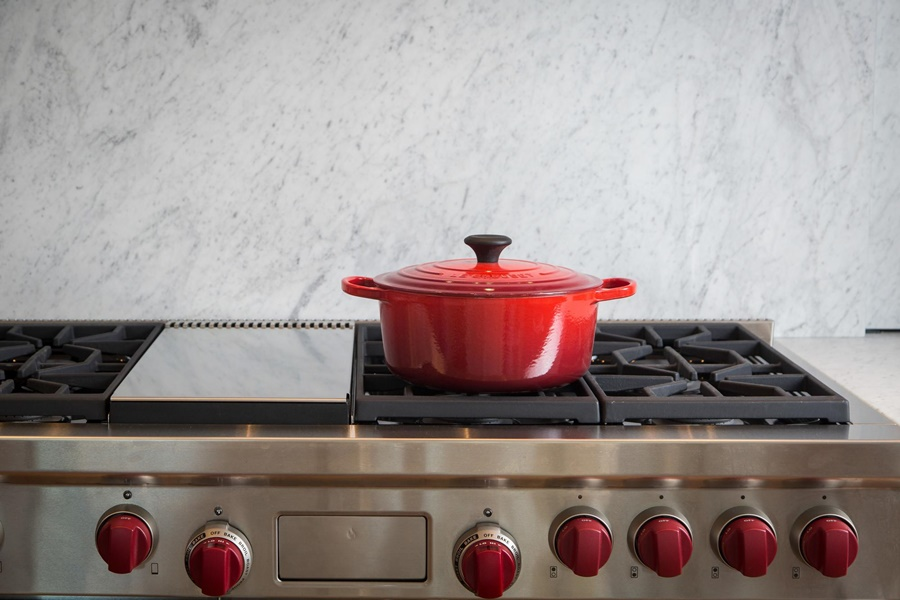 Red pot on a stovetop