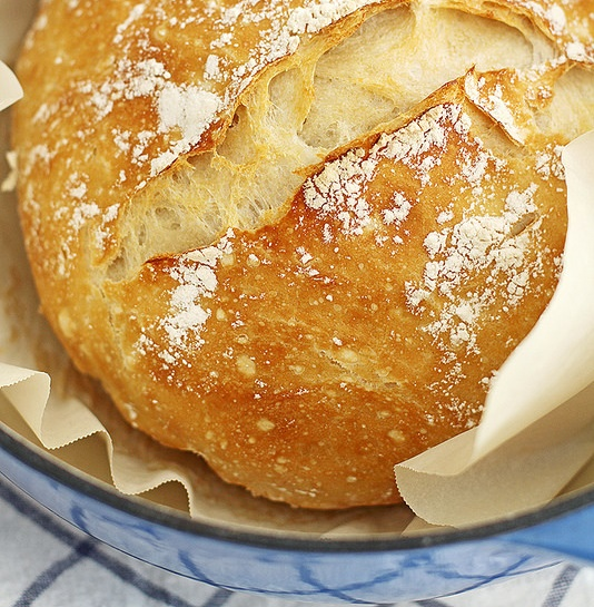 close up of baked bread in dutch oven