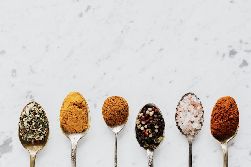 Different spices in tablespoons