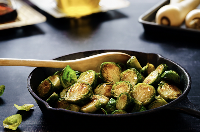 brussel sprouts in a cast iron pan